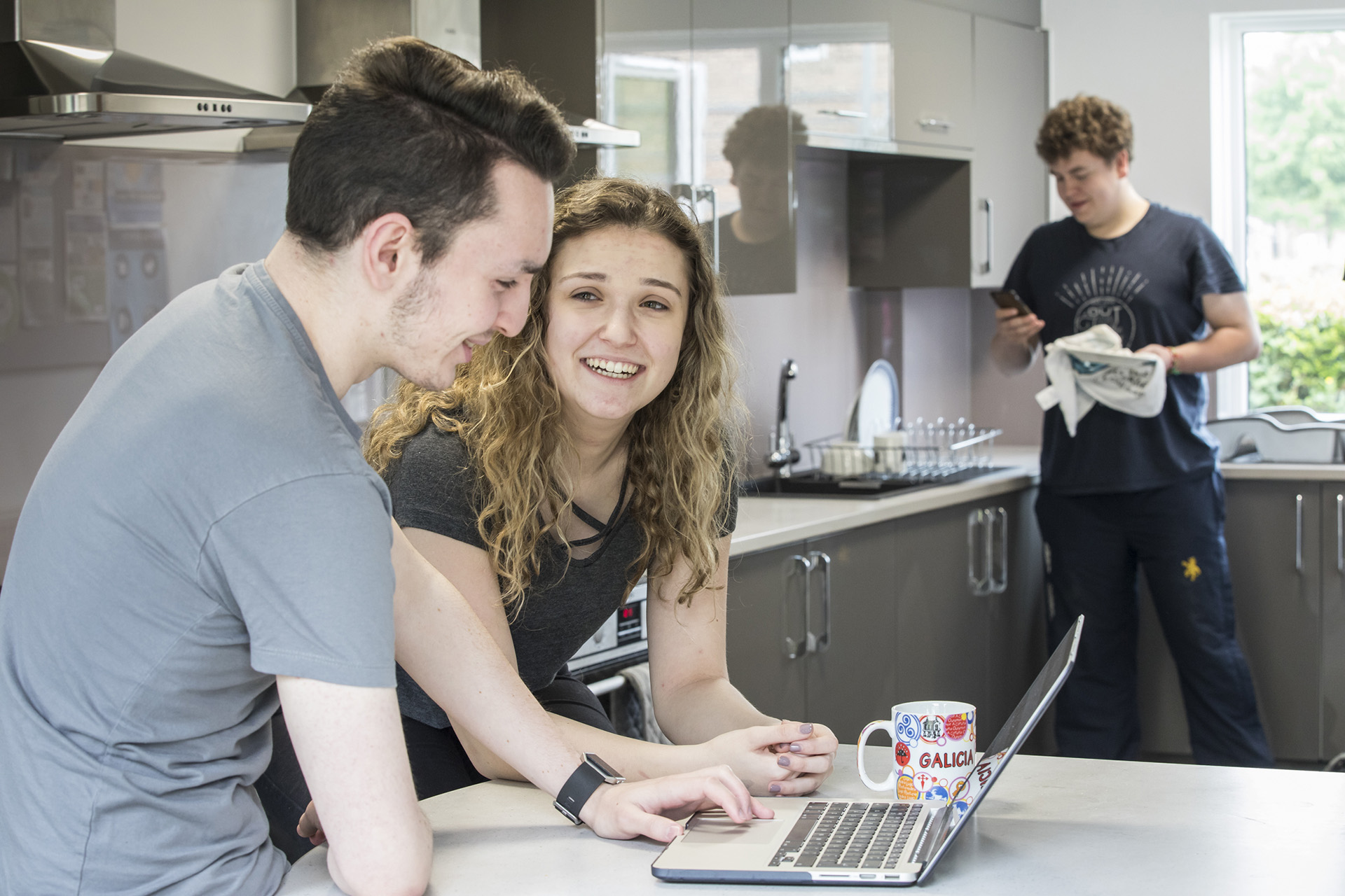 3 students in university accommodation kitchen