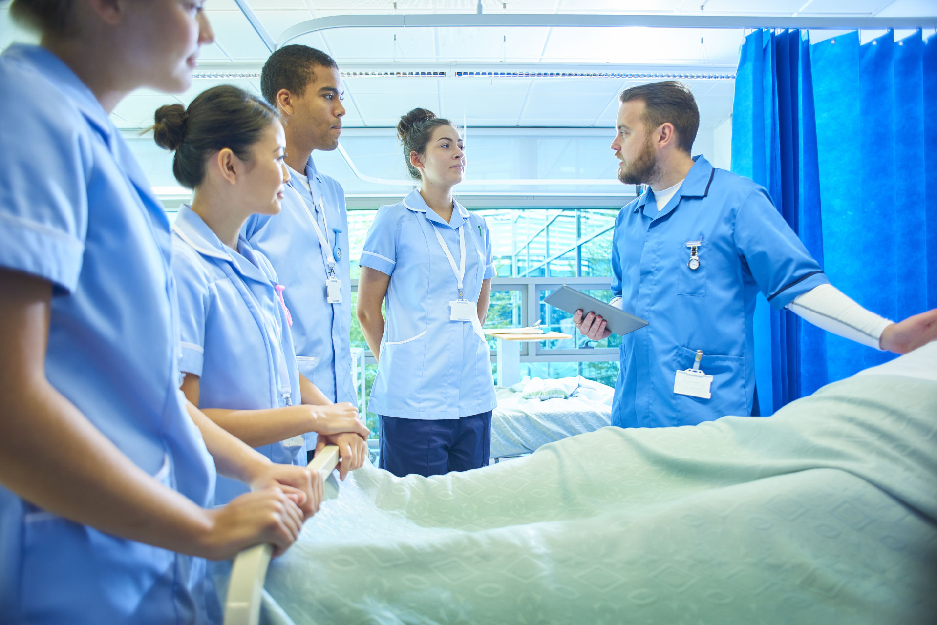 image of students around hospital bed