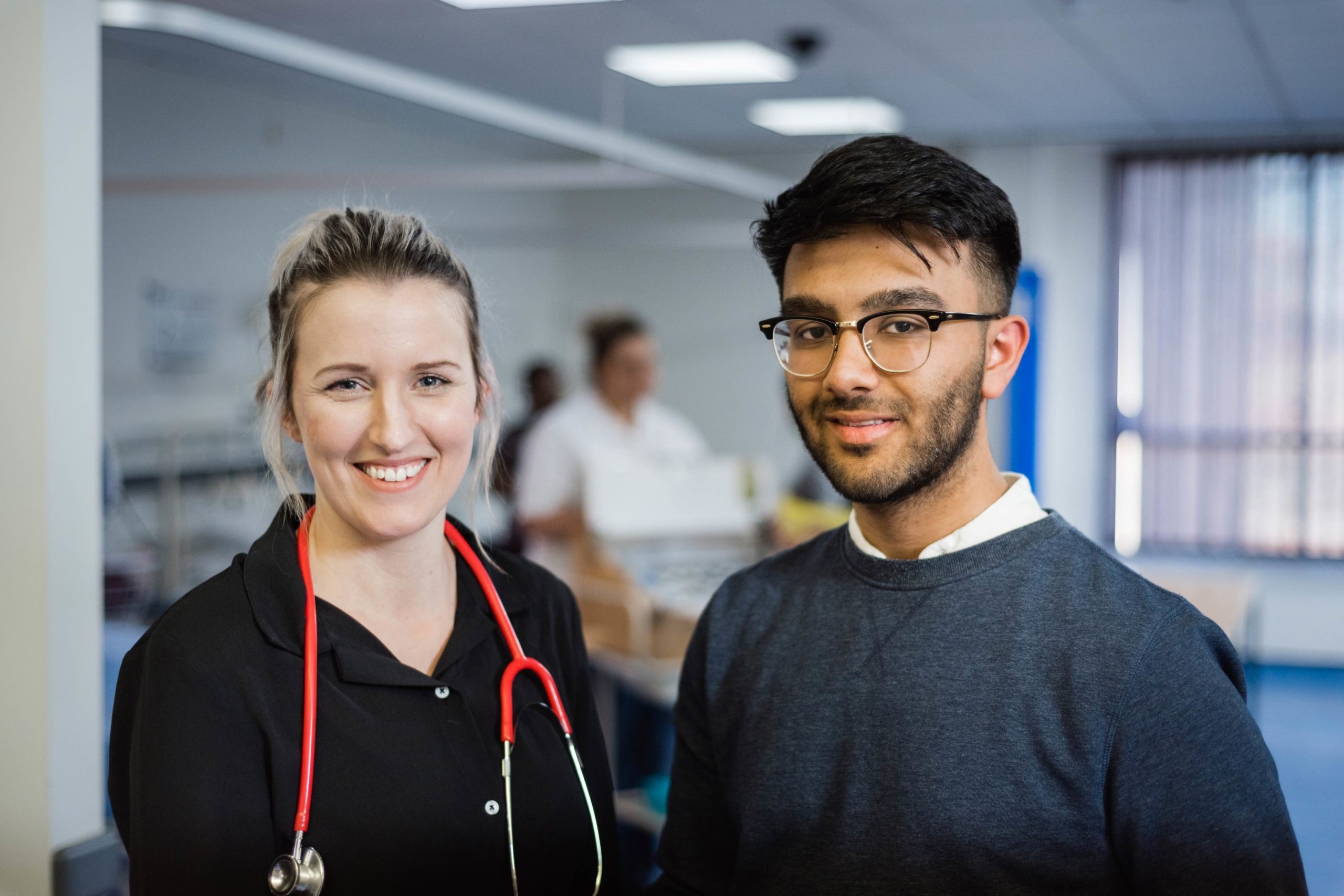 male and female student in a medical setting