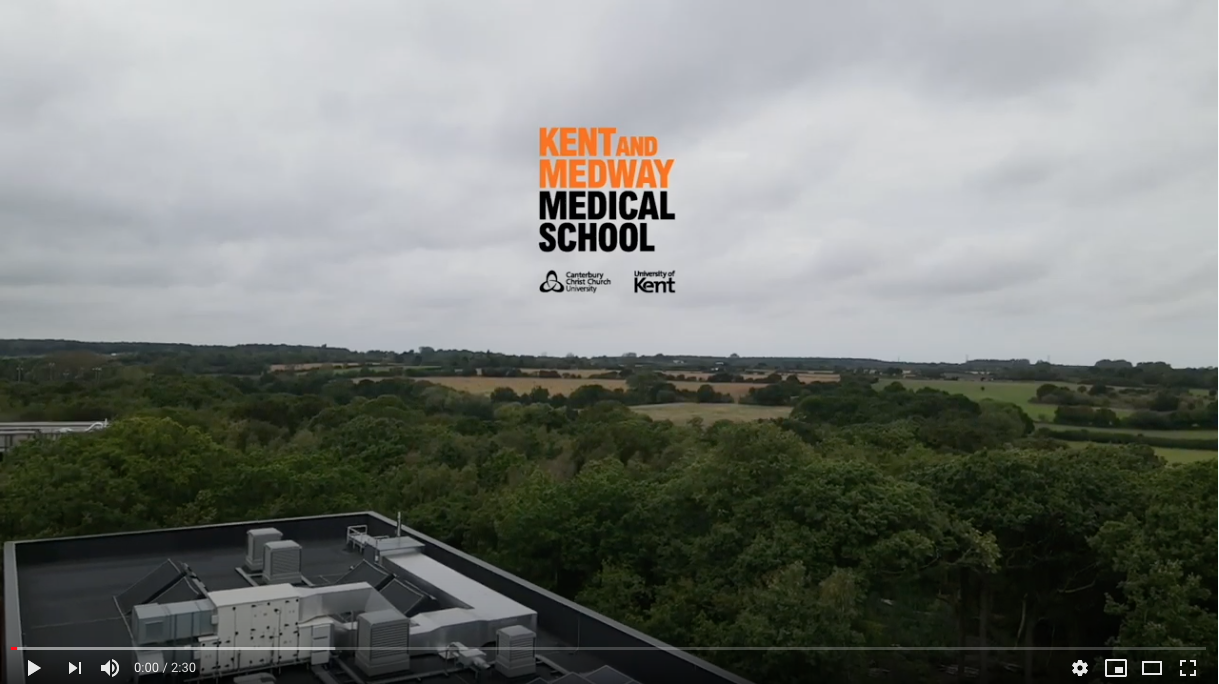 KMMS logo over fields
