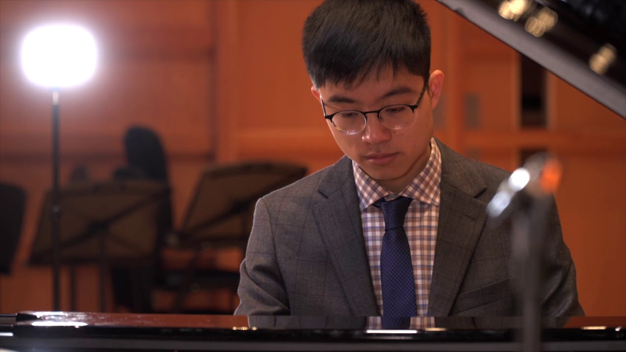 KMMS Student Michael Lam performing on the piano