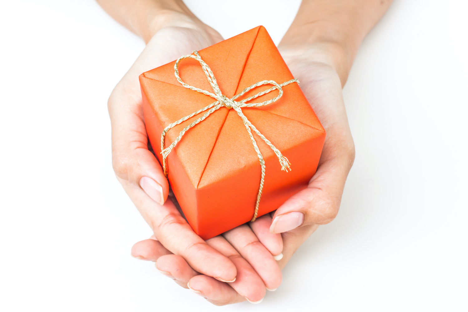 Two hands holding orange gift box